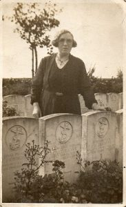 Maggie with her hand on son James' grave, killed 1918