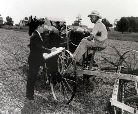 A census-taker interviews a farmer c 1940